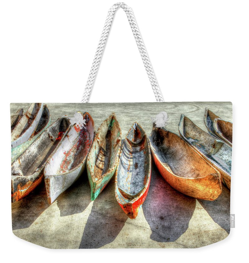 The Weekender Tote Bag featuring the photograph Canoes by Debra and Dave Vanderlaan