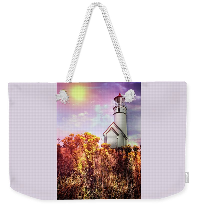 Clouds Weekender Tote Bag featuring the photograph Cape Blanco Lighthouse In Oregon by Debra and Dave Vanderlaan