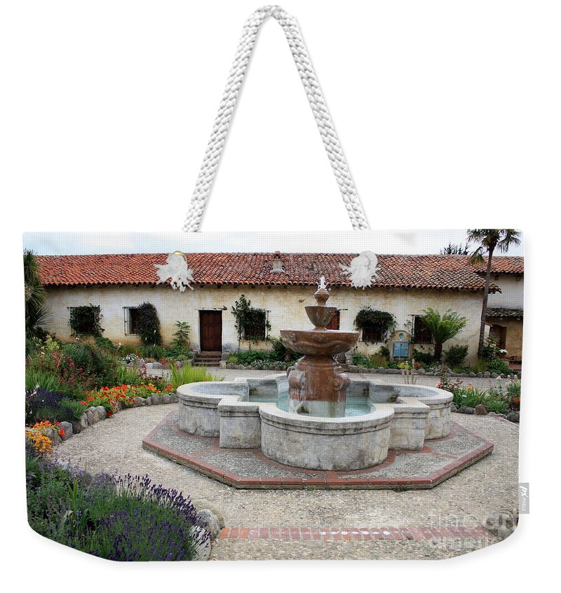 Catholic Weekender Tote Bag featuring the photograph Carmel Mission Courtyard by Carol Groenen