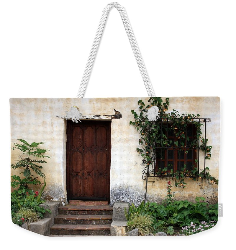 Carmel Mission Weekender Tote Bag featuring the photograph Carmel Mission Door by Carol Groenen