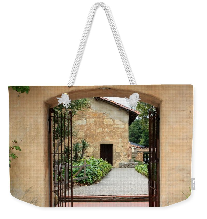 Carmel Mission Weekender Tote Bag featuring the photograph Carmel Mission Path by Carol Groenen