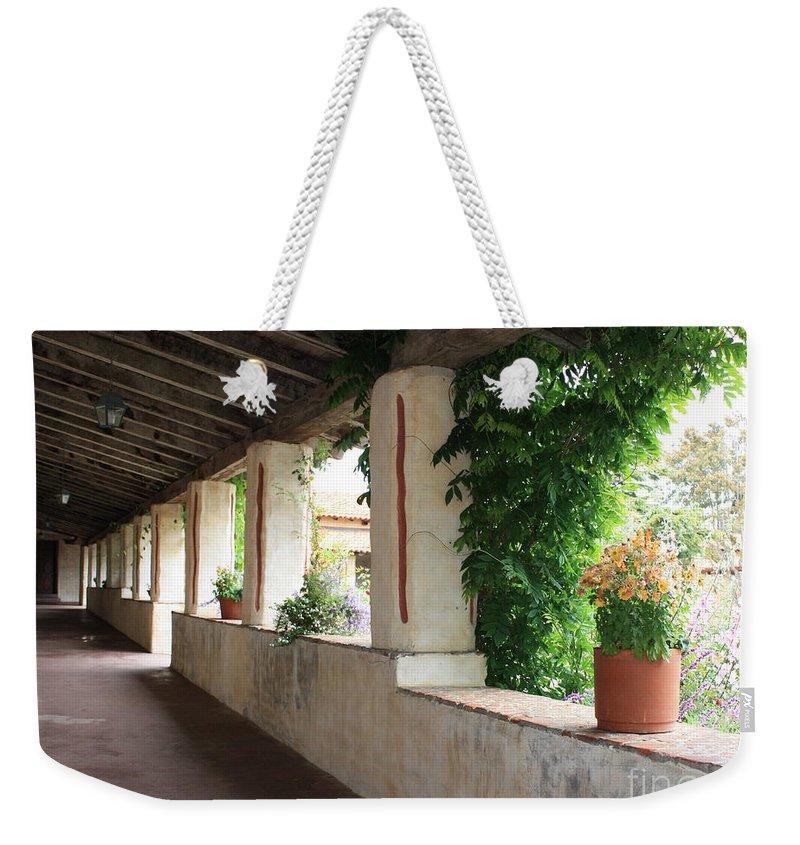 Carmel Mission Walkway Weekender Tote Bag featuring the photograph Carmel Mission Walkway by Carol Groenen