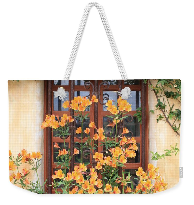 Alstroemeria Weekender Tote Bag featuring the photograph Carmel Mission Window by Carol Groenen