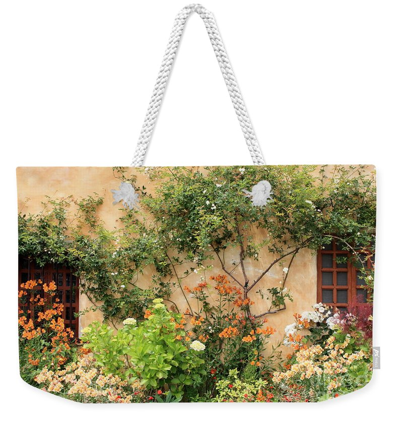 Carmel Mission Weekender Tote Bag featuring the photograph Carmel Mission Windows by Carol Groenen