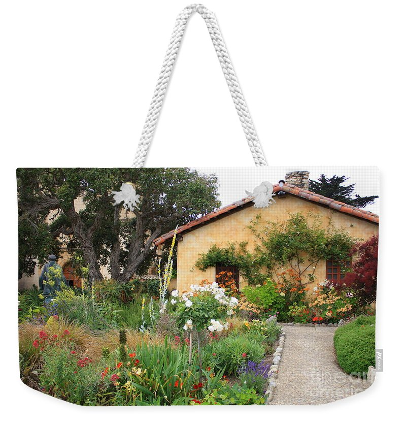 Carmel Weekender Tote Bag featuring the photograph Carmel Mission With Path by Carol Groenen
