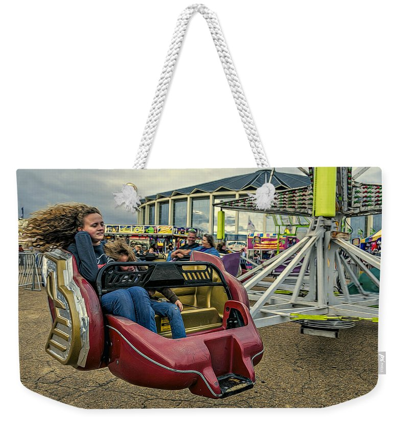 Action Weekender Tote Bag featuring the photograph Carnival Ride by Maria Coulson