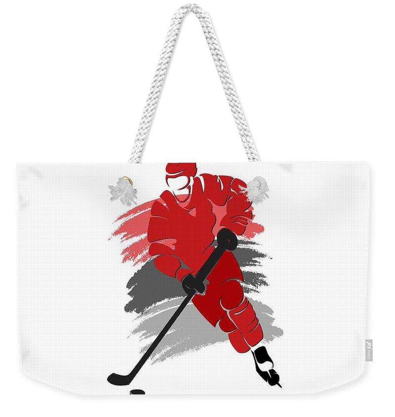 Hurricanes Weekender Tote Bag featuring the photograph Carolina Hurricanes Player Shirt by Joe Hamilton