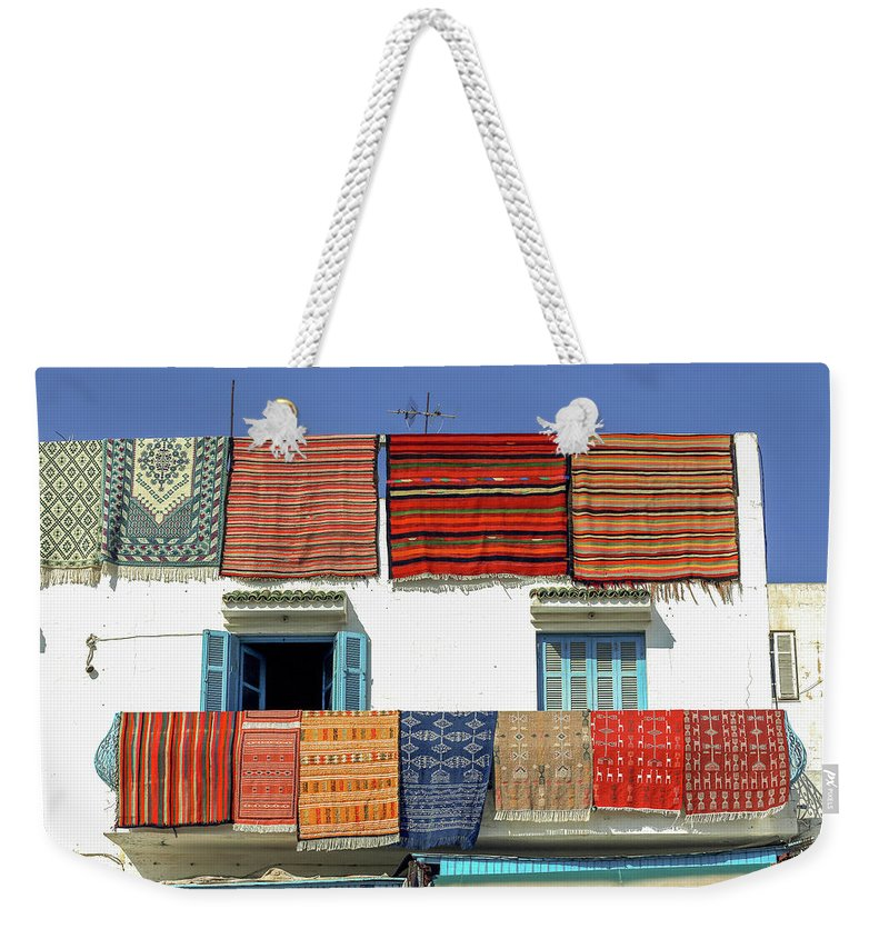 Tunisia Weekender Tote Bag featuring the photograph Carpets by Paul Fell