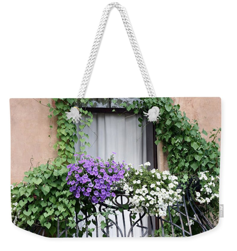 Windows And Doors Weekender Tote Bag featuring the photograph Cascading Floral Balcony by Donna Corless