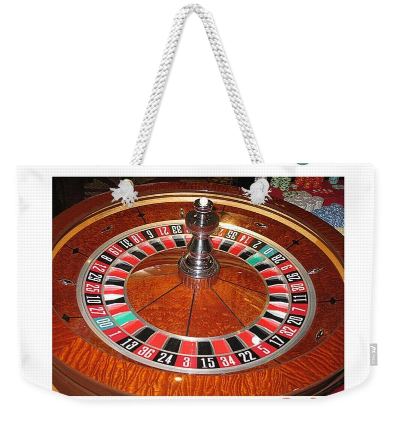 Casino Weekender Tote Bag featuring the photograph Casino Roulette Wheel Lucky Numbers by Tom Conway