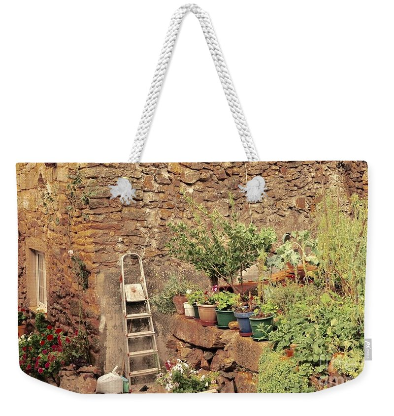Castelo Rodrigo Weekender Tote Bag featuring the photograph Castelo Rodrigo Garden by Csilla Florida