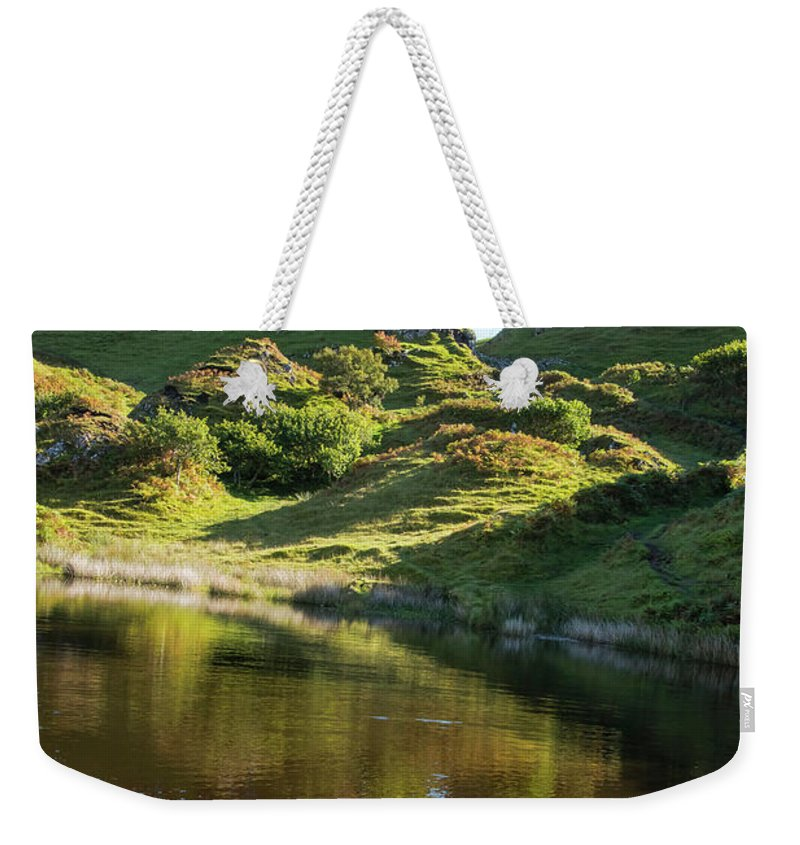 Fairy Glen Weekender Tote Bag featuring the photograph Castle Ewan With Reflection by Bob Phillips