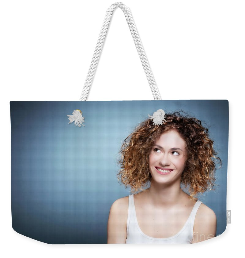 Girl Weekender Tote Bag featuring the photograph Casual Portrait Of A Cute, Authentic Girl. by Michal Bednarek