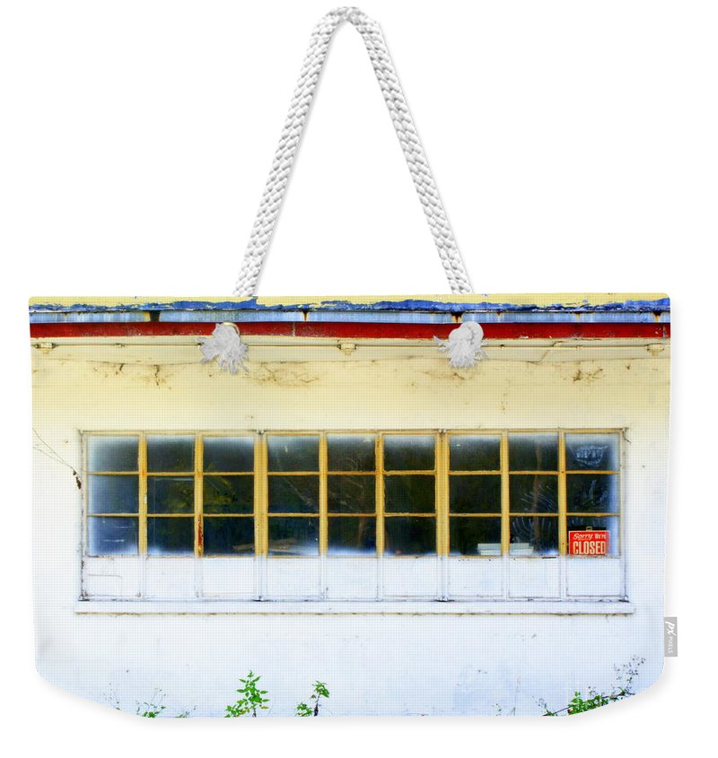 White Weekender Tote Bag featuring the photograph Casualty by Jennifer Diaz