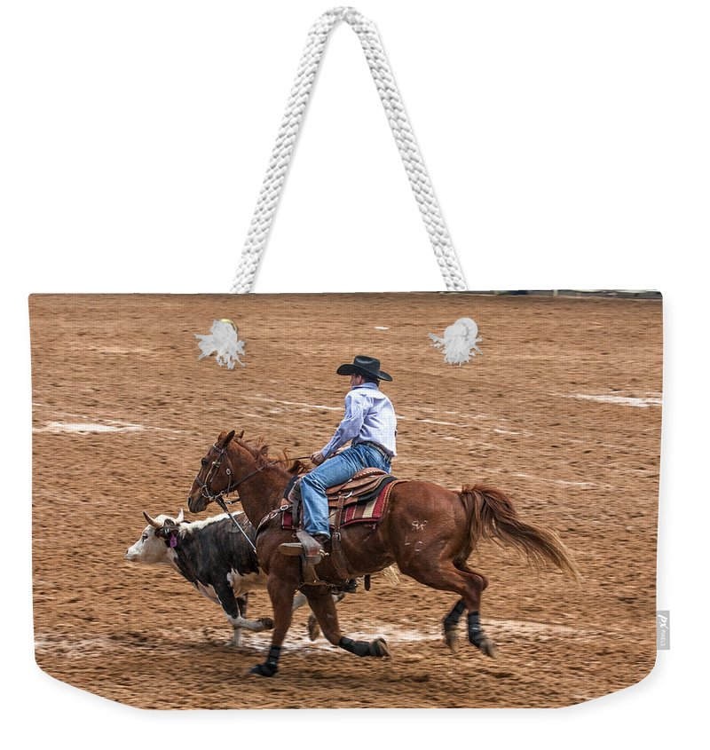 Rodeo Action Weekender Tote Bag featuring the photograph Catching Up by Sally Weigand