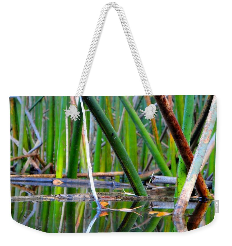 Pond Weekender Tote Bag featuring the photograph Cattail Reflections by Trinket's Legacy