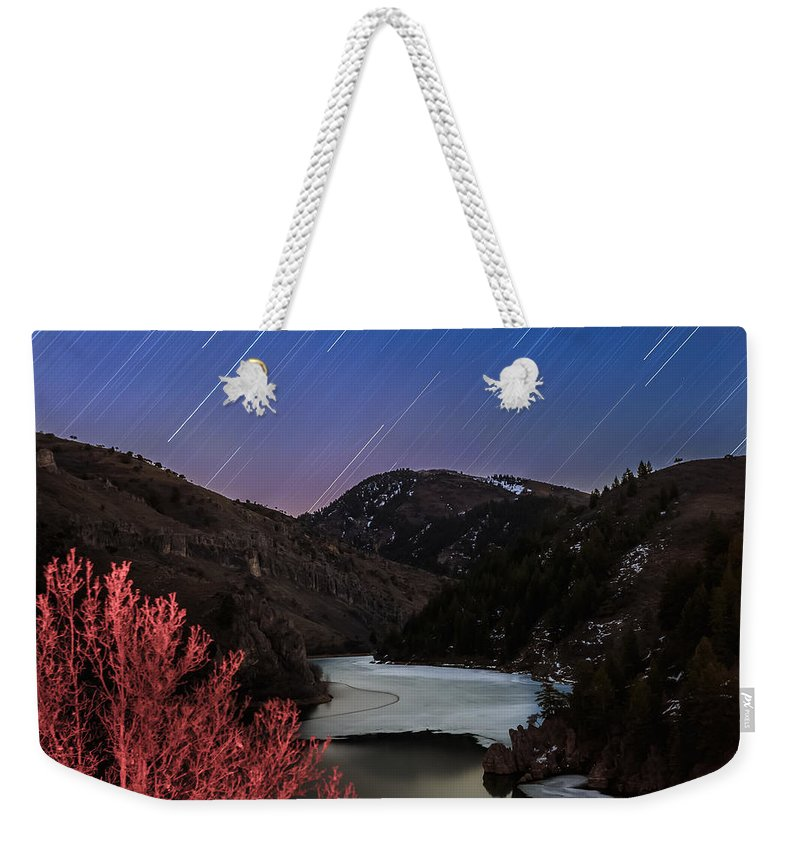 Trailsxposed Weekender Tote Bag featuring the photograph Raining Stars by Gina Herbert