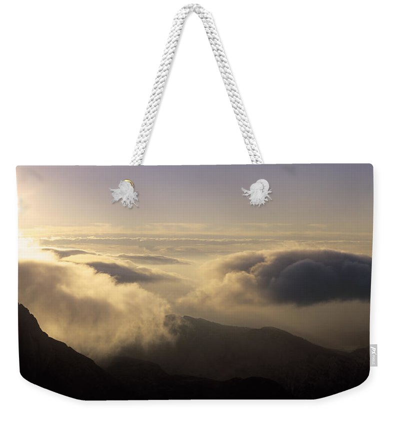 Alps Weekender Tote Bag featuring the photograph Celestial Wanderers by Konstantin Dikovsky