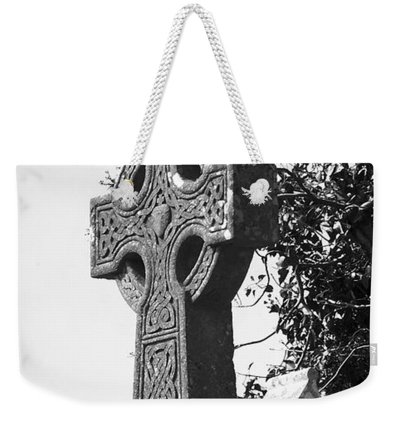 Celtic Weekender Tote Bag featuring the photograph Celtic Cross At Fuerty Cemetery Roscommon Ireland by Teresa Mucha