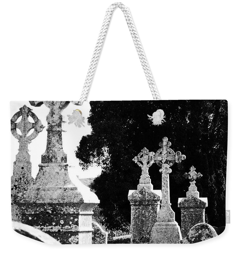Celtic Weekender Tote Bag featuring the photograph Celtic Crosses At Fuerty Cemetery Roscommon Ireland by Teresa Mucha