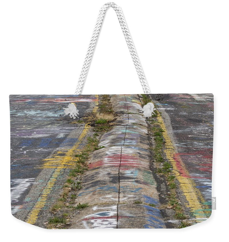 Centralia's Graffiti Highway 61 Weekender Tote Bag featuring the photograph Centralia Graffiti Highway by Tracy Winter