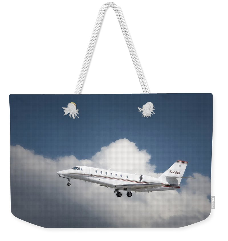 Aviation Weekender Tote Bag featuring the photograph Cessna 680 by Guy Whiteley