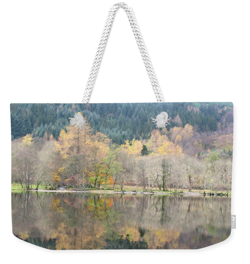 Autumn Weekender Tote Bag featuring the photograph Chasing Clouds Away by Maria Joy