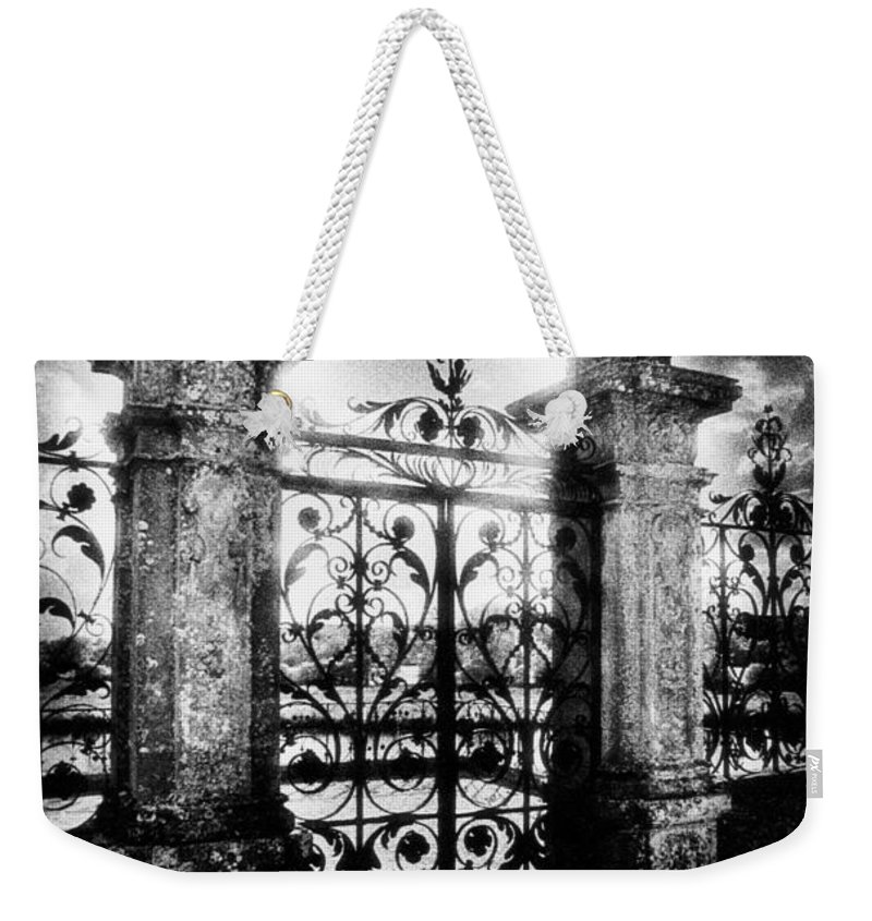 Gate; Wrought Iron; Posts; Pillars; Entrance; Portal; Grand; Grandiose; French; Metalwork; Ornate; Atmospheric; Spooky; Eerie; Fairytale; Moonlit; Moonlight; Dramatic; Portal; Castle; Renaissance; Baroque Weekender Tote Bag featuring the photograph Chateau De Carrouges by Simon Marsden