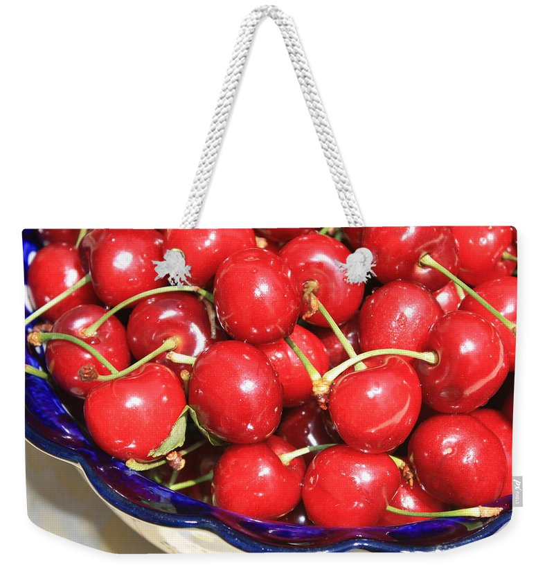 Food Weekender Tote Bag featuring the photograph Cherries In A Bowl Close-up by Carol Groenen