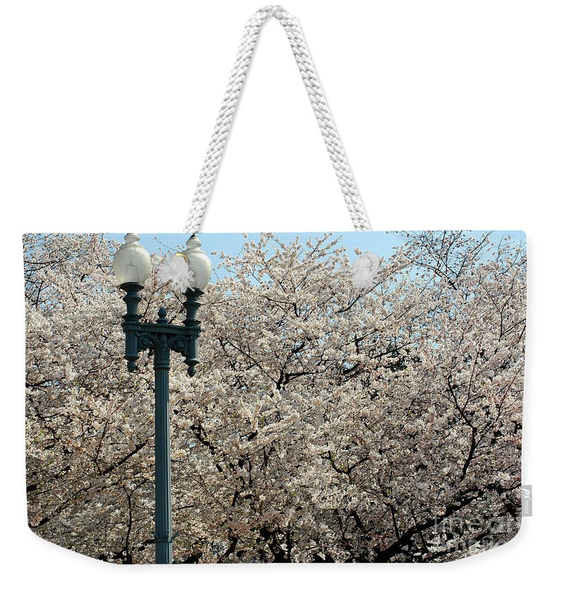 Clay Weekender Tote Bag featuring the photograph Cherry Blossom Festival by Clayton Bruster