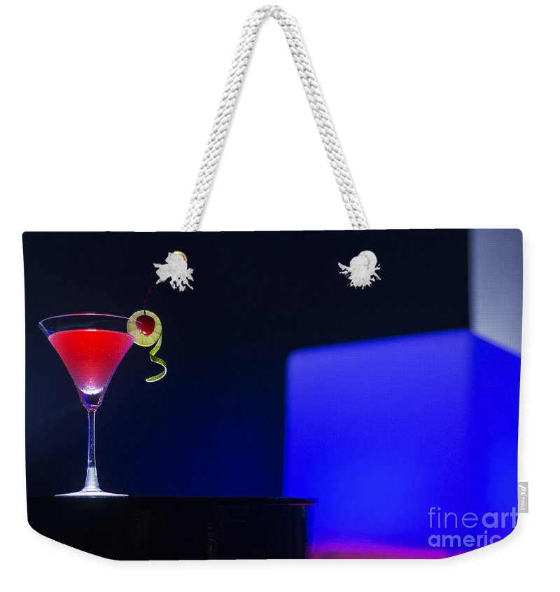 Alcohol Weekender Tote Bag featuring the photograph Cherry Martini Cocktail Drink At Night In Modern Bar by Jacek Malipan