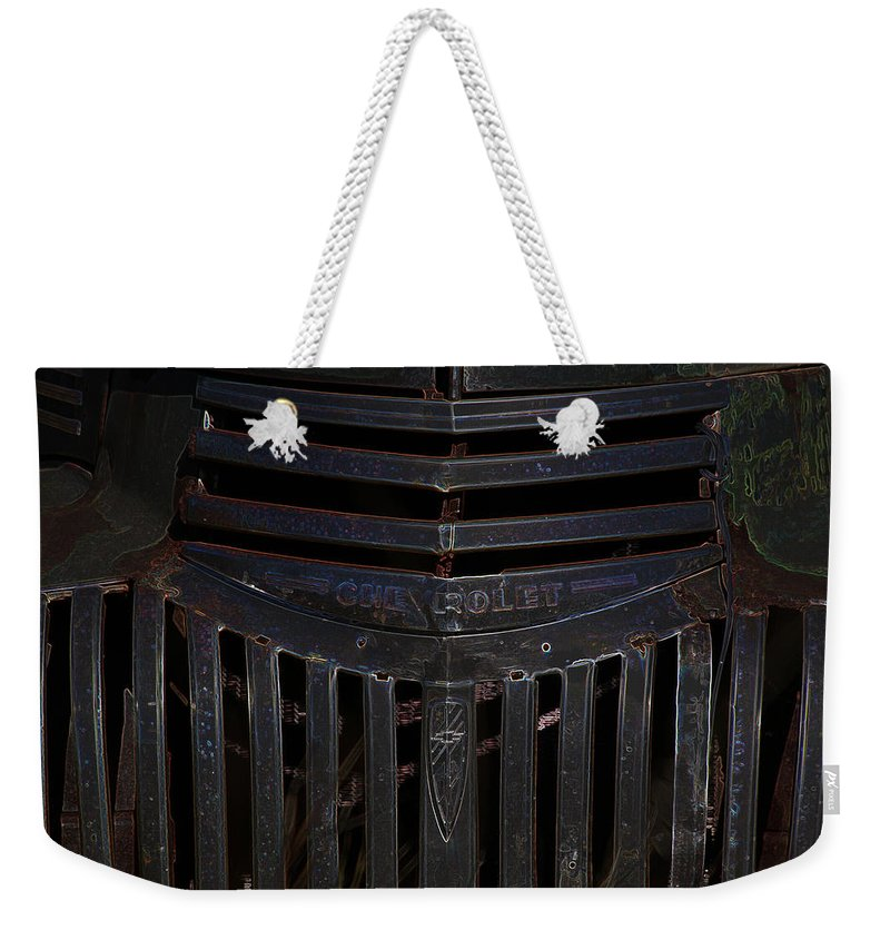 Old Antique Chevrolet Truck Car Vehicle 1950s Grill Weekender Tote Bag featuring the photograph Chevrolet by Andrea Lawrence