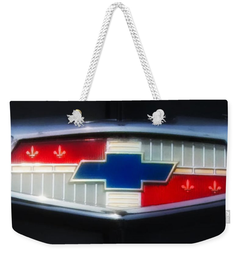 Chevy Weekender Tote Bag featuring the photograph Chevy Emblem by Bill Cannon