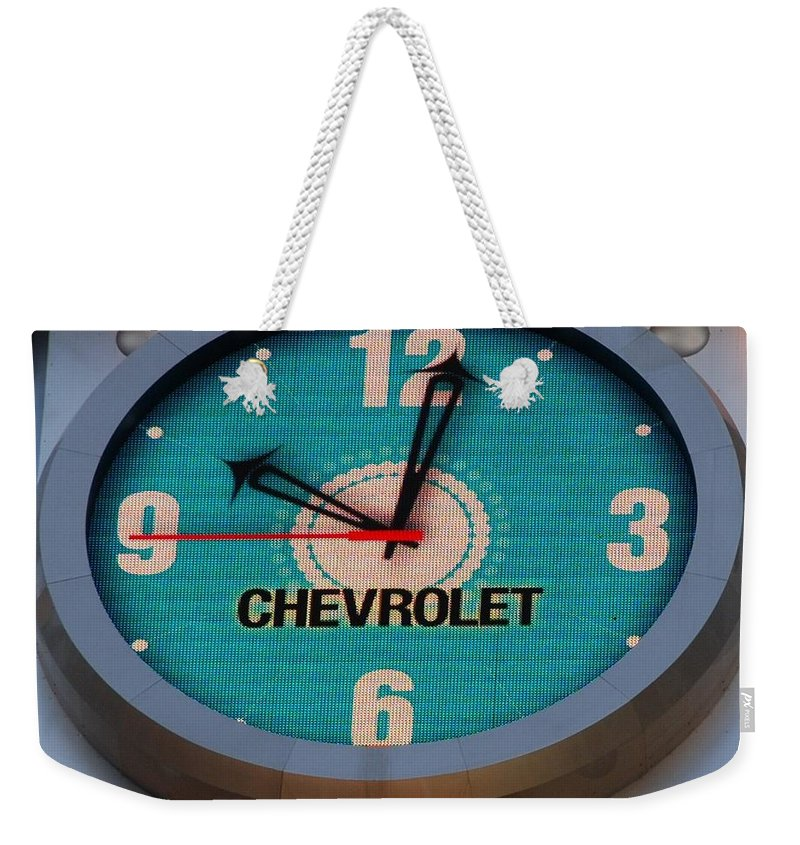 Clock Weekender Tote Bag featuring the photograph Chevy Neon Clock by Rob Hans