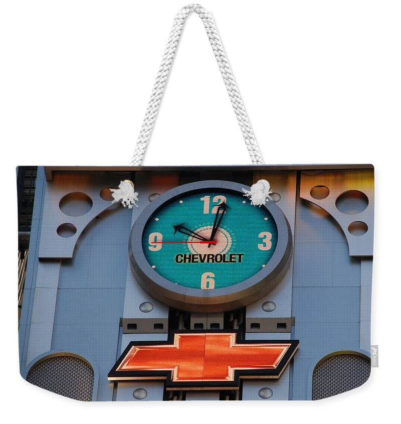Clock Weekender Tote Bag featuring the photograph Chevy Times Square Clock by Rob Hans