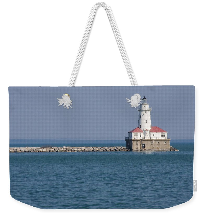 Chicago Windy City Lighthouse Light Harbor Lake Michigan Water Blue Sky Red Roof Safe Guide Weekender Tote Bag featuring the photograph Chicago Harbor Lighthouse by Andrei Shliakhau