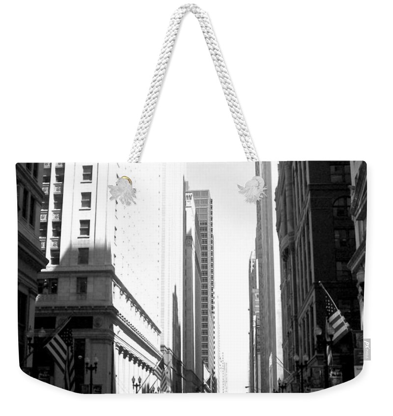 Chicago Weekender Tote Bag featuring the photograph Chicago Street With Flags B-w by Anita Burgermeister