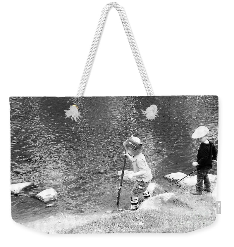 Kids Weekender Tote Bag featuring the photograph Children by Olga Zavgorodnya
