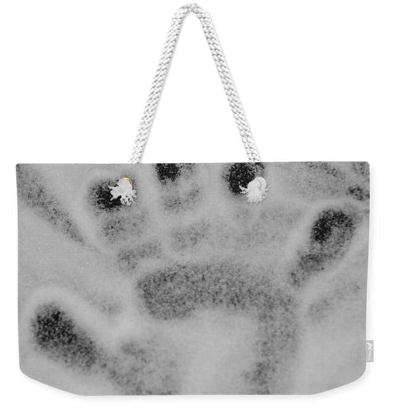 Black And White Weekender Tote Bag featuring the photograph Childs Hand by Rob Hans