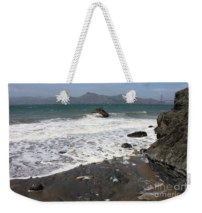 San Francisco Weekender Tote Bag featuring the photograph China Beach With Outgoing Wave by Carol Groenen