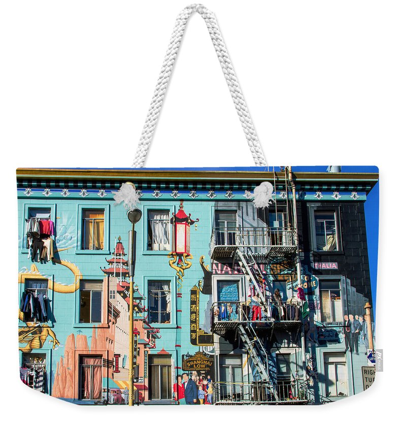 Bonnie Follett Weekender Tote Bag featuring the photograph Chinatown Mural On Broadway by Bonnie Follett