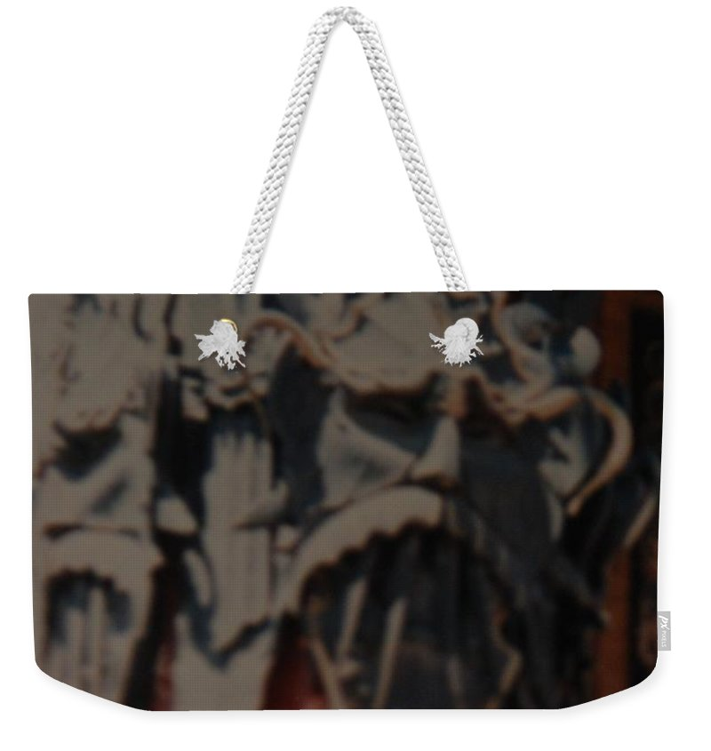 Grumanns Chinese Theater Weekender Tote Bag featuring the photograph Chinese Masks by Rob Hans