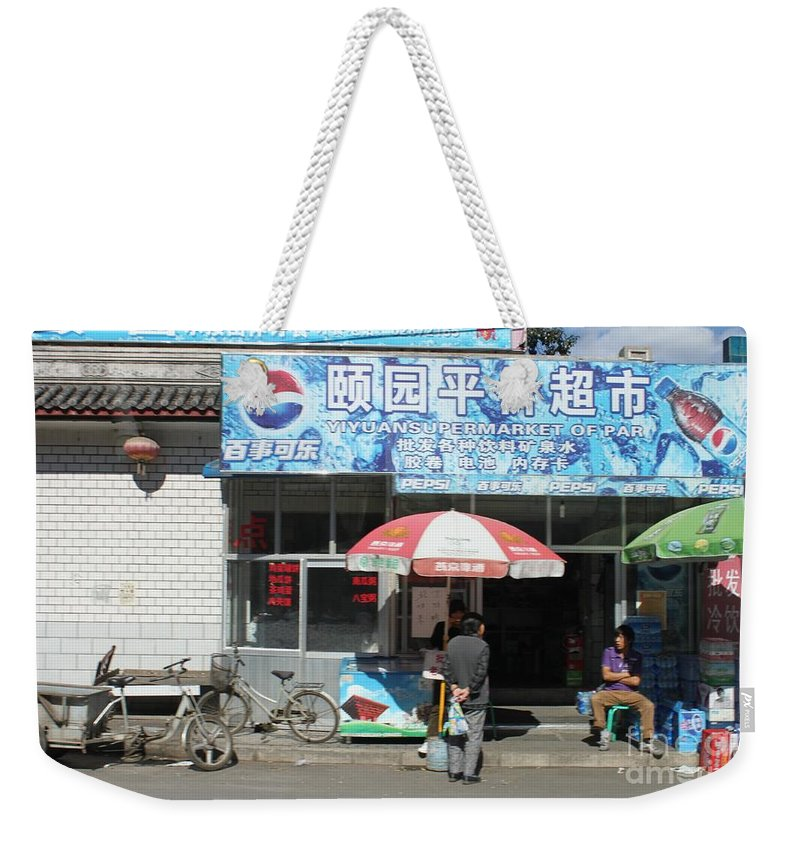 China Weekender Tote Bag featuring the photograph Chinese Storefront by Thomas Marchessault