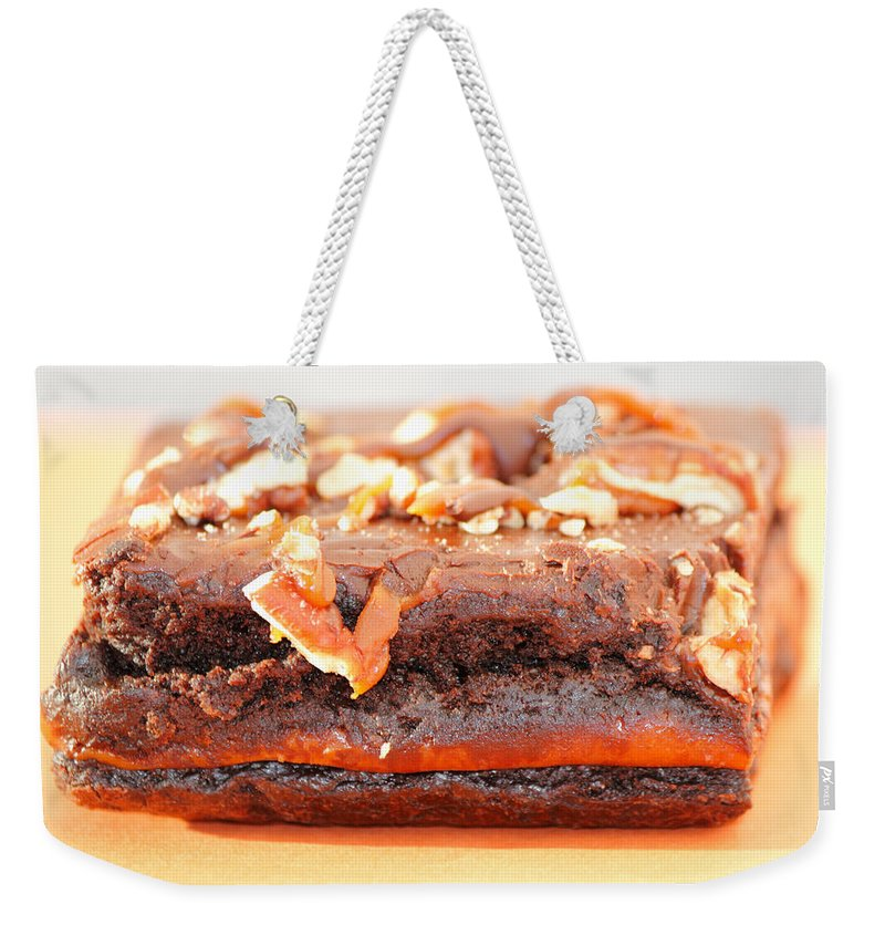 Brownie Weekender Tote Bag featuring the photograph Chocolate Brownie With Nuts Dessert by Lee Serenethos