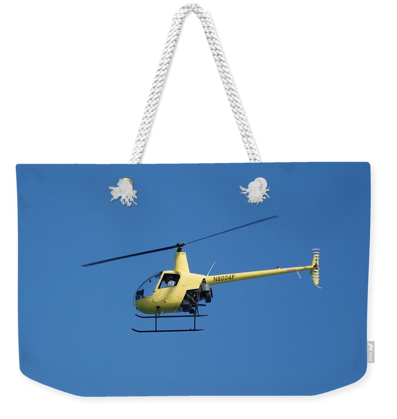 Yellow Weekender Tote Bag featuring the photograph Chopper by Rob Hans