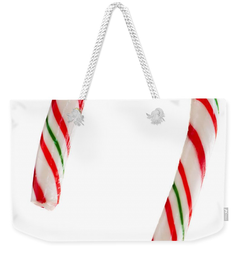 Candy Weekender Tote Bag featuring the photograph Christmas Candy Cane by Elena Elisseeva