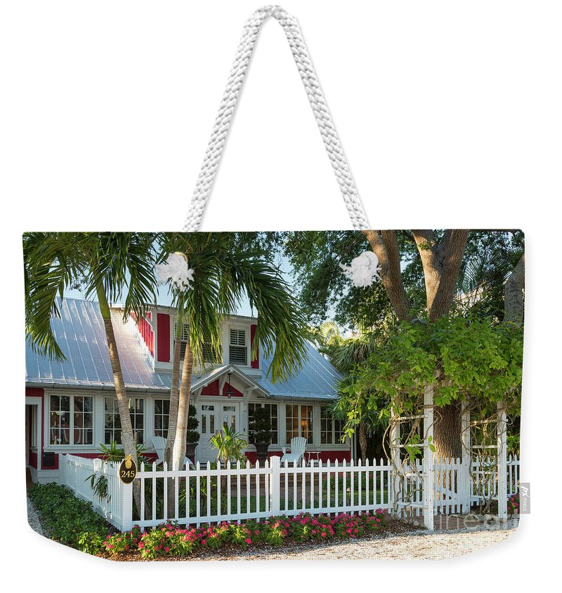 America Weekender Tote Bag featuring the photograph Christmas Cottage - Naples by Brian Jannsen