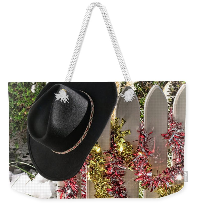 Merry Weekender Tote Bag featuring the photograph Christmas Cowboy Hat On Fence - Merry Christmas by Olivier Le Queinec