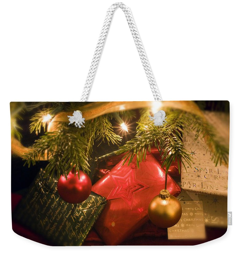 Christmas Weekender Tote Bag featuring the photograph Christmas Tree Decorations And Gifts by Mal Bray