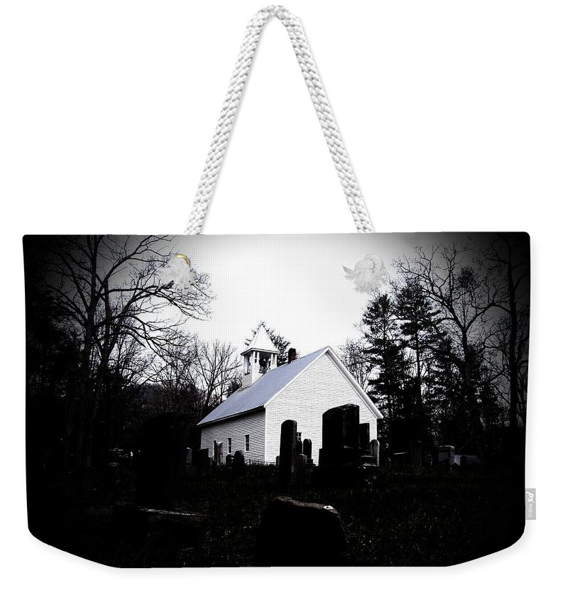 Black Weekender Tote Bag featuring the photograph Church And Cemetary- Lens by Charleen Treasures